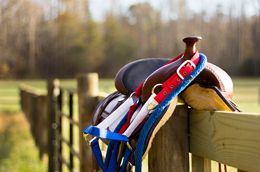 A saddle on the fence at Peace Reins